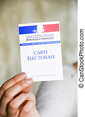 french electoral card - woman holding a french election card...