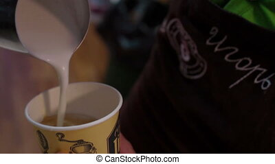 Professional barista prepares latte in coffee shop - Barista...
