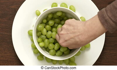 Overhead Timelapse of Couple Eating Green Grapes From Bowl...