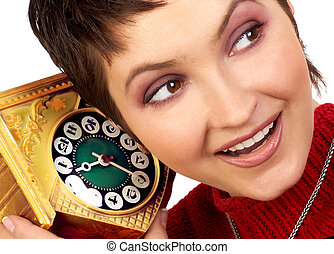 woman with a clock - Happy woman hearing an old clock Over...