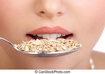 Healthy eating - Pretty  woman holding a spoon with muesli