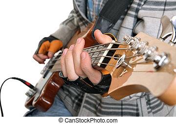 Hands of a rock musician with bass guitar