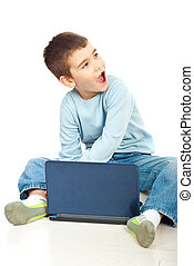 Boy with notebook looks surprised