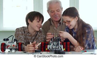 Children spend time with grandpa