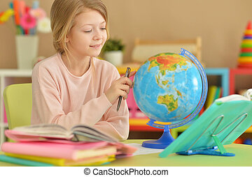 Cute girl does lessons - Portrait of a cute girl does...