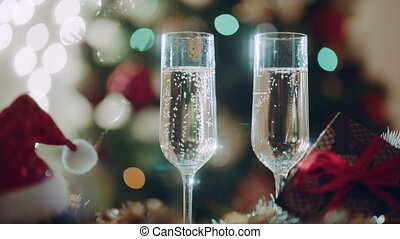 Two glasses with champagne on Christmas Eve. Christmas...