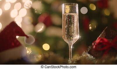 Glass filled with champagne on New Years night. Christmas...