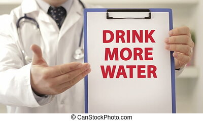 Doctor advice patient to drink more water - Doctor wearing a...