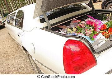 flowers in limousine - Wedding bouquet lies on the car