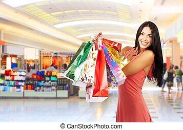Shopping woman - Shopping young woman smiling in the...