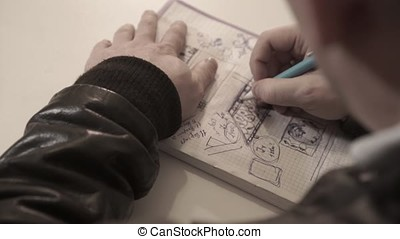 The man draws in a notebook,taking notes, the person writes in a diary, notebook. lose Up Portrait Asian Man Thinking And Writing In A Notebook. Writing In Small Notebook Journal. Man Writing In Notebook. Writing Header Of To Do List In Notebook With Marker or pencil. Writing