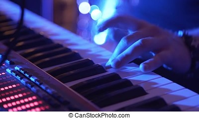 Closeup Of Male Hands Playing Piano. Man Playing The Synthesizer Keyboard. Man Plays Music Keyboard. Musician Plays Piano. A Musician Playing A Musical Instrument DJ plays the piano at the party