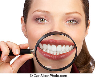 Healthy teeth - Young woman showing her healthy teeth....