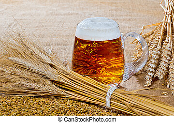 beer glass with sheaf of barley and wheat