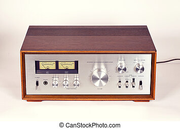 Vintage Stereo Audio Amplifier in Wooden cabinet frontal...