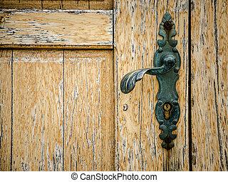 old wooden door with door knob - part of old wooden door...
