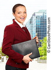 Young smiling business woman with eyeglasses