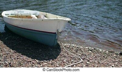 Rowing boat at shore