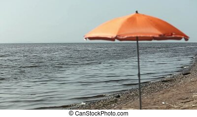 umbrella on an empty beach seascape