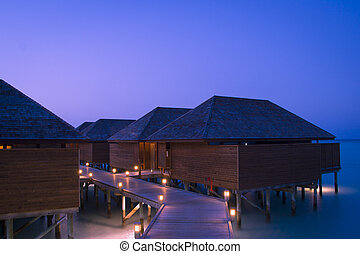 Tropical resort at the blue hour - a Maldives tropical...