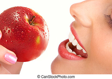 woman with apple - Beautiful young woman eating a red apple....