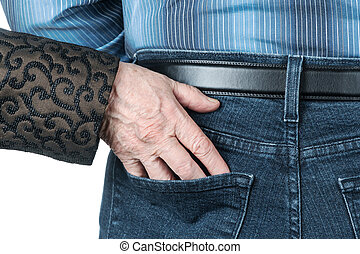 Senile hand in the pocket of man - Wrinkled hand of an old...