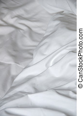 Messy and creased white fabric of bedsheet - Detail on the...