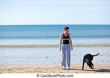 Athletic woman doing sport with dog