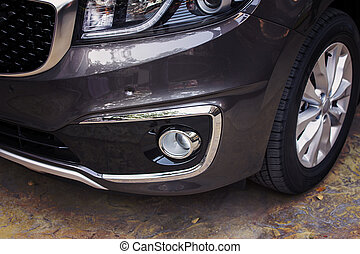 Front bumper dark grey color of luxury car in front-side view.