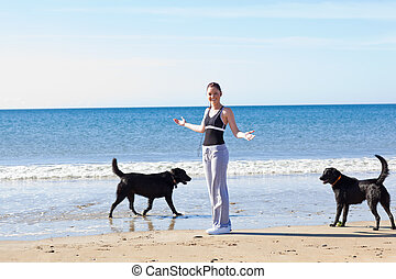 Woman doing sport with her dogs