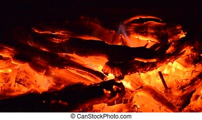 Campfire with hot coals - Hot coals and flames in burning...