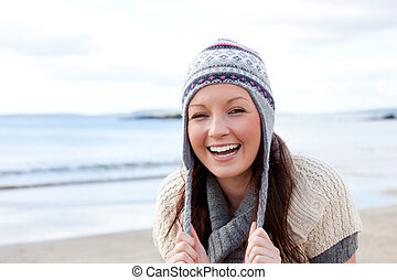 Excited woman on the beach having the giggles