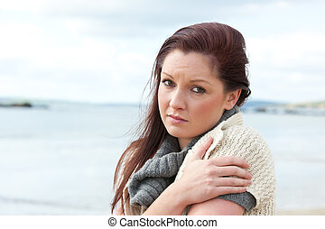 Pensive woman on the beach
