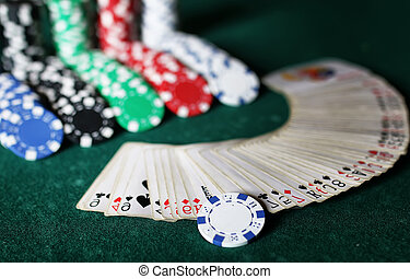 poker chips on the table - set of chips and cards on green...