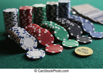 set of chips and cards on a green baize gambling casino -...