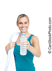 Woman holding water bottle with a towel
