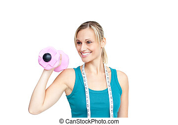 Smling young woman holding a dumbell over a white background