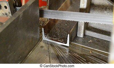Metal cutting saw - A horizontal metal cutting saw with oil...