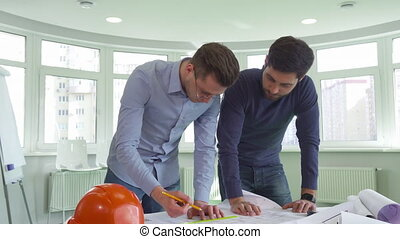 Two architects work on the project at the office