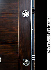 Steel door lock system - Wood looking front door, internal...