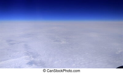 Fly Over Clouds - Flight over clouds. Panning dolly shot
