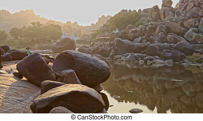 Calm River with Steep Banks Huge Grey Stones at Sunrise -...