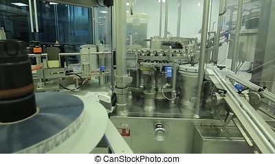 Pharmaceutics. Pharmaceutical worker operates tablet blister packaging machine. manufacture of syringes. syringe. pharmaceutical industry. Line machine conveyer for packaging glass bottles ampoules in boxes at factory. pharmaceutical medicine industrial washer cleaning and drying bottles. pharmaceutical medicine industrial production line with plastic bottles for liquid drugs. Packaging line for the production of medicines plant. Industry. pharmaceutical packing production line conveyer at manufacture pharmacy factory. Authentic shot in challenging conditions. maybe little blurred. pharmaceutical industry. Production line machine conveyor with glass bottles ampoules at factory. Tablet or Capsule counting machine in factory. Science and medicine