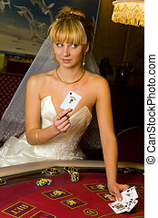 happy bride in a casino - happy bride playing cards in a...