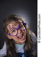 Funny four years girl making faces - Portrait of a funny...