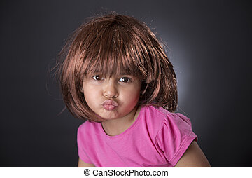 Four years girl pouting - Portrait of a funny four years...