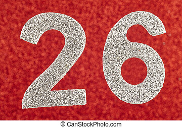 Number twenty-six silver color over a red background....