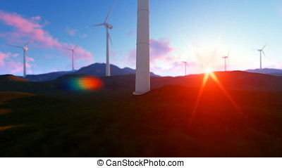 Wind turbine farm on green meadow, rays of light at sunrise, tilt