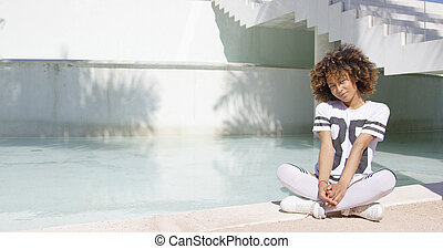 Female sitting with legs crossed - Smiling female wearing...