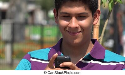 Male Teen Texting Using Cell Phone